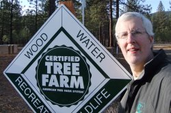 Randall with Tree Farm sign